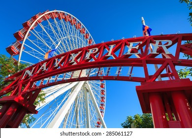 Chicago, Illinois USA - August 25, 2011: The popular Navy Pier with ferris wheel is a popular tourist destination in downtown Chicago.