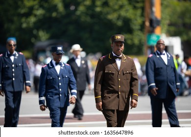 Chicago, Illinois, USA - August 8, 2019: The Bud Billiken Parade, Members of the Nation of Islam, wearing uniforms, marching down the street at the parade