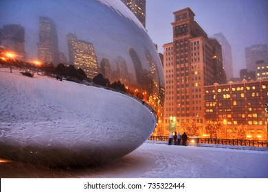 CHICAGO, ILLINOIS, USA - DECEMBER 16, 2008: Snowy winter night in the center of Chicago. Atmosphere in a Millennium park during snowfall, shallow depth of field.