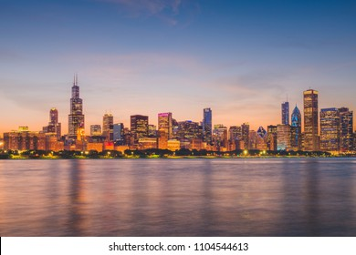 Chicago, Illinois, USA downtown skyline from Lake Michigan at dusk.