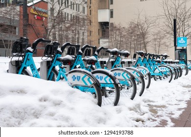 Chicago, Illinois / USA - January 21, 2019: A Row of Divvy Bikes covered in Snow during a light Snow Storm