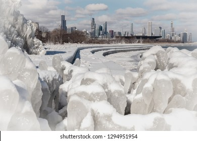 Chicago, Illinois / USA - January 21, 2109 Beautiful view of the skyline from the icy formations south of the city.  The lake kicked up water and created this beautiful winter wonderland scene.
