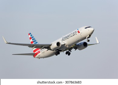 Chicago, Illinois / USA - July 12, 2015: View of an American Airlines Boeing 737-800 passenger jet taking off from runway 22L at Chicago O'Hare International Airport (ORD).