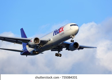 Chicago, Illinois, USA - July 13, 2017: FedEx Express Boeing 767-300 cargo jet aircraft arriving for a landing at O'Hare International Airport in Chicago, Illinois, USA.
