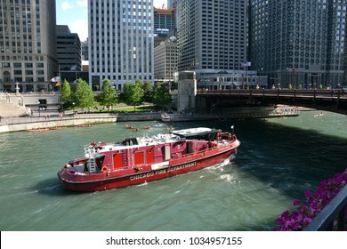 Chicago, Illinois / USA - July 14, 2016: Full view of vintage Chicago Fire Department boat cruising the Chicago River on a summer day.