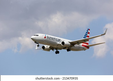 CHICAGO, ILLINOIS / USA - July 20th, 2013: View of an American Airlines Boeing 737-800 passenger jet in new American paint scheme on approach to landing at Chicago O'Hare International Airport (ORD).