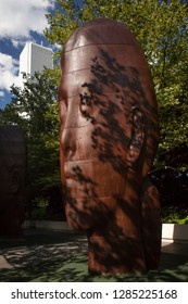 Chicago, Illinois, USA – July 27, 2014: Vertical shot of one the sculptures of Jaume Plensa 1004 Portraits installation for the Millenium Park 10th Anniversary