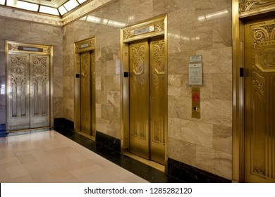 Chicago, Illinois, USA – July 27, 2014: Horizontal view of the luxury gold elevators of the art deco Carbide and Carbon Building, 230 N Michigan Ave