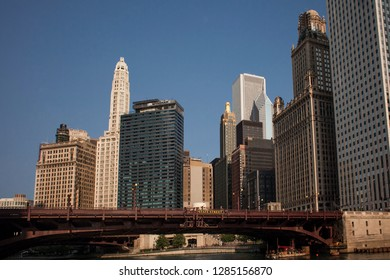 Chicago, Illinois, USA – July 28, 2014: Horizontal view of State Street Bridge and Chicago skyline, with Carbide and Carbon and Jewelers Buildings, from an Architecture Cruise on a sunny afternoon