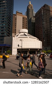 Chicago, Illinois, USA – July 28, 2014: Vertical view of people crossing Wacker Pl with Seventeenth Church of Christ Scientist and art deco Carbide and Carbon Building in the background, Chicago Loop