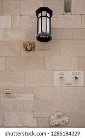 Chicago, Illinois, USA – July 28, 2014: Vertical view of a part of the Herald Tribune Tower façade with some embedded stones from different origins, 435 N Michigan Ave