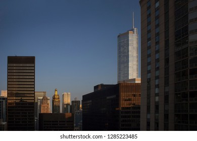 Chicago, Illinois, USA – July 28, 2014: Horizontal panoramic sunrise shot of the top of some emblematic skyscrapers, like Carbide & Carbon building or Trump Tower, from a high point of view