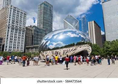 "Chicago, Illinois, USA - July 3, 2014: Tourist around the Cloud Gate (""The Beam"") at the Millennium Park in Chicago, Illinois"