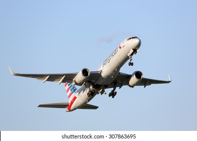 Chicago, Illinois / USA - July 30, 2015: View of an American Airlines Boeing 757-200 passenger jet taking off from runway 22L at Chicago O'Hare International Airport.  New American paint scheme.
