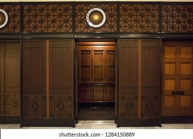 Chicago, Illinois, USA – July 31, 2018: Horizontal shot of an antique wooden elevator of the Railway Exchange Building (now Santa Fe Building), 224 S. Michigan Av