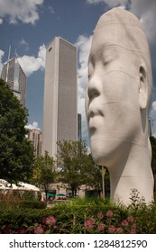 "Chicago, Illinois, USA – July 31, 2014: Vertical shot of ""Looking into my dreams, Awilda"", one the sculptures of Jaume Plensa 1004 Portraits installation for the Millenium Park 10th Anniversary"