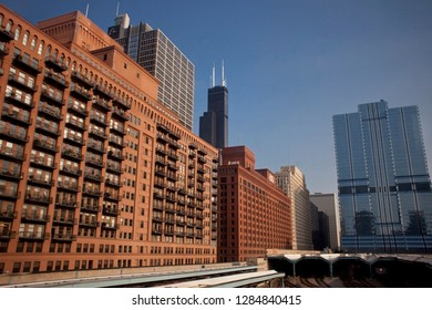 Chicago, Illinois, USA – July 31, 2014: Horizontal panoramic view of the West Loop from a pink line train of Chicago L, with the The Gogo Building (River Center) and Willis Tower in the background