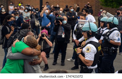 Chicago, Illinois / USA - June 1, 2020:  Peaceful Protesters in a protest against the death in Minneapolis police custody of African-American man George Floyd, in Uptown Neighborhood of Chicago