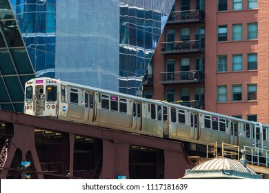 "CHICAGO, ILLINOIS, USA - June 16, 2018: A Chicago Transit Authority (CTA) train travels along the ""L"" near Chicago's Loop."