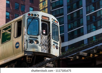 """CHICAGO, ILLINOIS, USA - June 16, 2018: A Chicago Transit Authority (CTA) train travels along the """"L"""" near Chicago's Loop."""