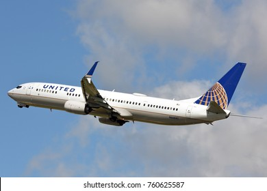 Chicago, Illinois / USA - June 18, 2017 - United Airlines Boeing 737 taking off from runway 22L at Chicago O'Hare International Airport to begin its short domestic flight.