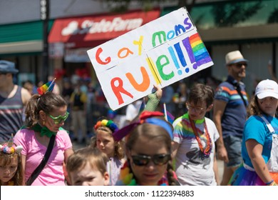 Chicago, Illinois, USA - June 24, 2018 Child carries sign that say, Gay Moms Rule, during the LGBTQ Pride Parade in Chicago
