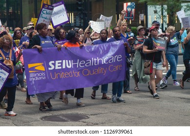CHICAGO, ILLINOIS USA - JUNE 30, 2018: Service Employees International Union members march at the Families Belong Together rally representing healthcare workers.