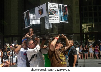 CHICAGO, ILLINOIS USA - JUNE 30, 2018: Demonstrators at the Families Belong Together rally dramatize the plight of migrant children in cages.