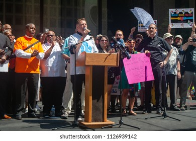CHICAGO, ILLINOIS USA - JUNE 30, 2018: Father Michael Pfleger speaks to demonstrators at the Families Belong Together rally.