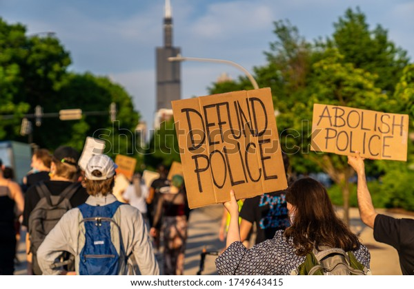Chicago, Illinois / USA - June 4 2020: Peaceful Protest Sign 'defund the police' and 'abolish police' in Downtown Chicago, West Loop Neighborhood over George Floyd Death.