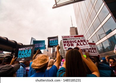 CHICAGO, ILLINOIS, USA - JUNE 8, 2019: Group of people gather for the first ever Medicare For All Rally led by Bernie Sanders. People hold up signs in support of the movement.