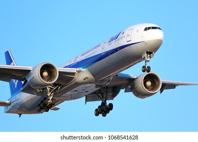 Chicago, Illinois / USA - March 10, 2018: All Nippon Airways (ANA) Boeing 777 on final approach to O'Hare International Airport in Chicago on a sunny morning.