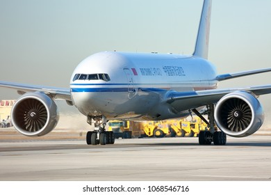 CHICAGO, ILLINOIS / USA - March 10, 2018: An Air China Cargo transport aircraft taxiing to the cargo terminal at the O'Hare International Airport in Chicago on a sunny morning