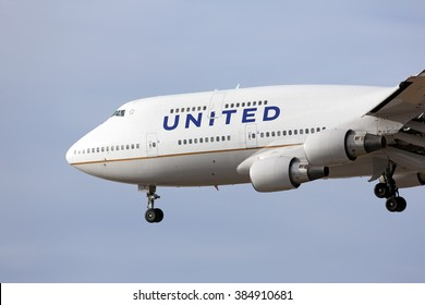 Chicago, Illinois, USA - March 15, 2015: United Airlines Boeing 747 jumbo jet airplane descending for a landing at O'Hare International Airport in Chicago, Illinois, USA.