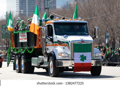 Chicago, Illinois, USA - March 16, 2019: St. Patrick's Day Parade, Large truck Peterbilt with Irish flags going down columbus dr.