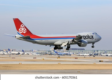 Chicago, Illinois, USA - March 19, 2017: Cargolux Boeing 747-8F cargo jet airplane arriving for a landing at O'Hare International Airport in Chicago, Illinois, USA.