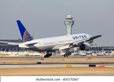 Chicago, Illinois, USA - March 19, 2017: United Airlines Boeing 777 passenger jet airplane arriving for a landing at O'Hare International Airport in Chicago, Illinois, USA.