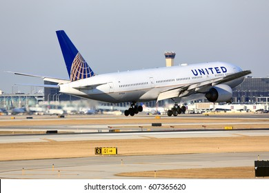 Chicago, Illinois, USA - March 19, 2017: United Airlines Boeing 777-200 passenger jet airliner arriving for a landing at O'Hare International Airport in Chicago, Illinois, USA.