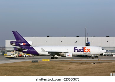 CHICAGO, ILLINOIS, USA - March 19, 2017: Photo of a FedEx cargo aircraft (McDonnell Douglas MD-11F) taxiing to base at the O'Hare International Airport (ORD)