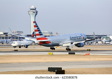 Chicago, Illinois, USA - March 19, 2017: American Airlines Boeing 767-300 passenger jet airliner arriving for a landing at O'Hare International Airport in Chicago, Illinois, USA.