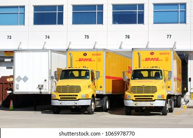 Chicago, Illinois, USA - March 3, 2018: A DHL trucks and trailers parked at a DHL warehouse, cargo distribution facility at the International Airport in Chicago.