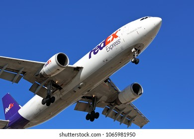 Chicago, Illinois / USA - March 3, 2018: A FedEx Airbus A300F commercial cargo aircraft approaching the runway for landing at the Chicago O'Hare International Airport and a cloudless morning.