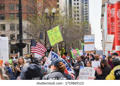 Chicago, Illinois / USA - May 1, 2020: Civil protest in Downtown Chicago against the restrictions placed upon the citizens by Governor J.B. Pritzker in front of the James R. Thompson Center.