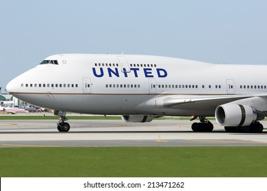CHICAGO, ILLINOIS / USA - May 10, 2014: A United Airlines Boeing 747-400 rolling down the runway at O'Hare Airport during it's regular passenger flight.  These aircraft make frequent flights to O'Hare