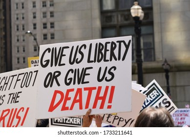 Chicago, Illinois / USA - May 16, 2020: Protesters hold a political rally in defiance of Illinois Governor J.B. Pritzker's stay at home order in downtown Chicago and demand the state re-open.