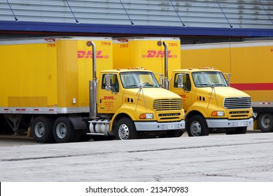 Chicago, Illinois, USA - May 3, 2014: DHL trucks and trailers parked at a cargo distribution hub at Chicago's O'Hare International Airport. Chicago - May 3, 2014