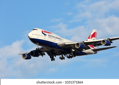 CHICAGO, ILLINOIS / USA - November 24, 2017: British Airways Jumbo Jet Boeing 747-400 on final approach to O'Hare International Airport completing its cross-Atlantic flight from Europe.