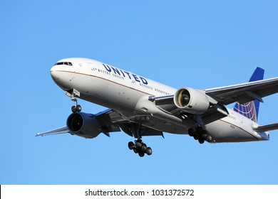 CHICAGO, ILLINOIS / USA - November 24, 2017: A wide-body United Airlines Boeing 777-200 on final approach to O'Hare International Airport completing its long distance flight from Asia.
