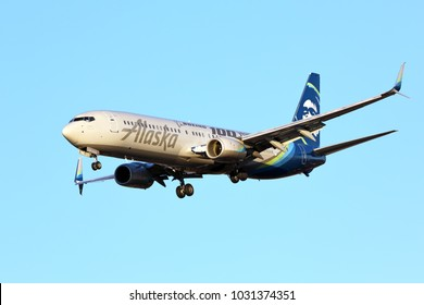 CHICAGO, ILLINOIS / USA - November 24, 2017: Alaska Airlines Boeing 737-900 on final approach to O'Hare International Airport completing its flight from the West Coast. Wearing a special Boeing paint