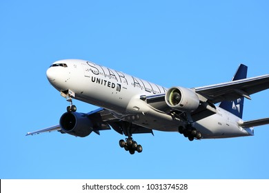 CHICAGO, ILLINOIS / USA - November 24, 2017: A wide-body Star Alliance United Airlines Boeing 777-200 on final approach to O'Hare International Airport completing its long distance flight from Asia.